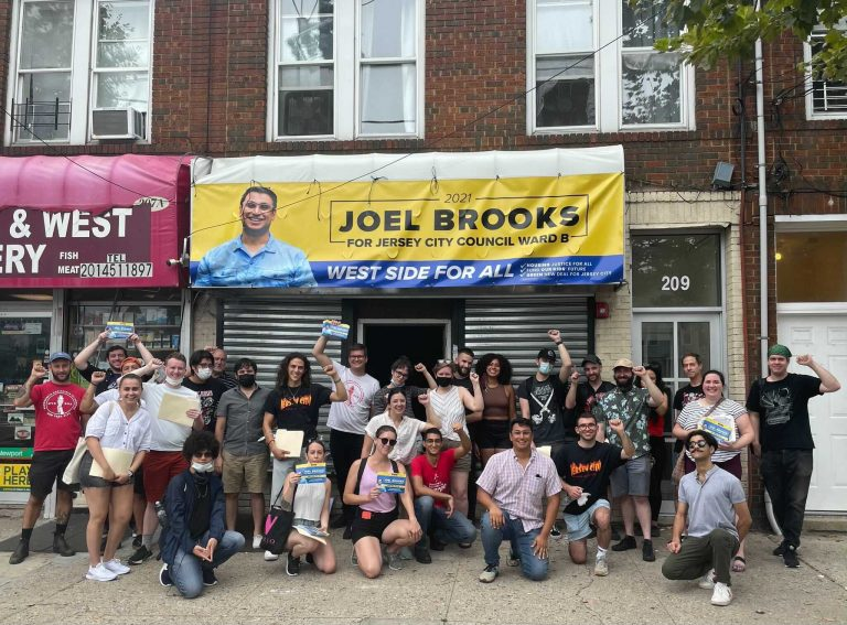 Group of canvassers supporting Joel Brooks for Jersey City in front of their campaign office.